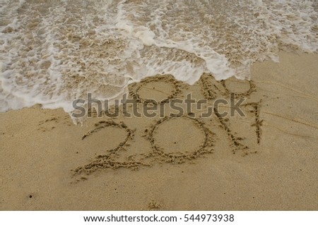 Happy New Year 2017 replace 2016 year concept on the beach