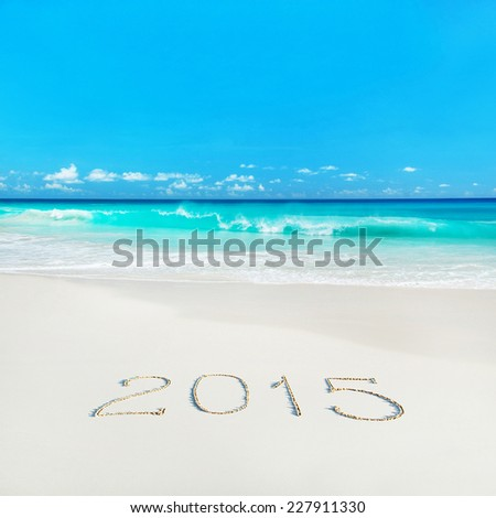 Happy New Year 2015 season concept on azure tropical sandy beach - winter vacation in hot countries background  - stock photo