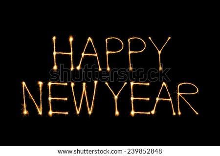 Happy New Year 2015 sparkle firework on black background - stock photo