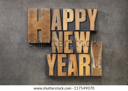 Happy New Year! - text in vintage letterpress wood type blocks on a grunge metal background - stock photo