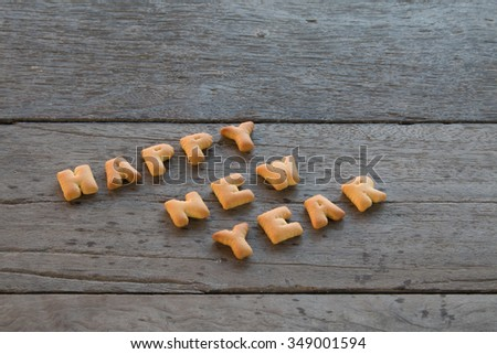 Happy New Year text with cookies the wooden background