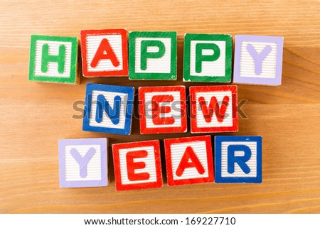 Happy new year toy block - stock photo