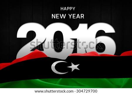 Happy New Year 2016 typography and Libya waving Flag - stock photo