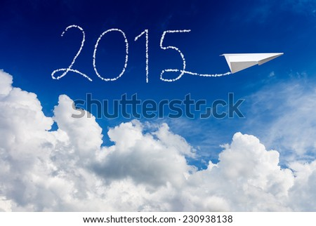 happy new year 2015! white cloud, blue sky and paper plane on sunny day - stock photo
