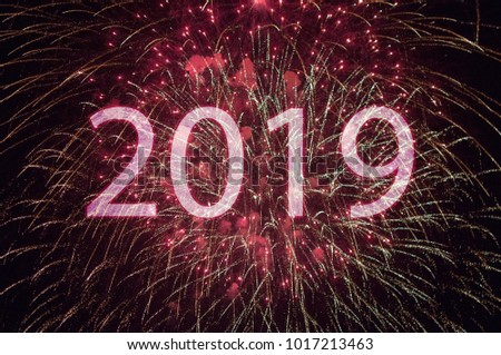 Happy New Year 2019 with colorful sparklers. The numbers 2019 are integrated into the fireworks on black background