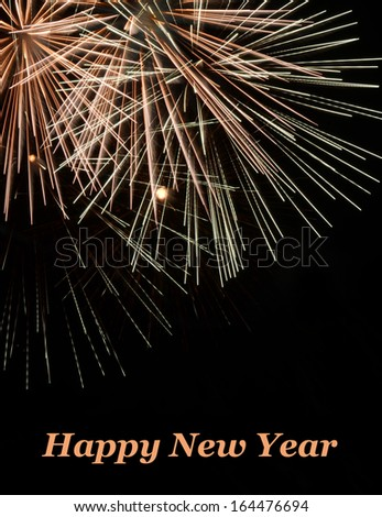 Happy New Year With Exploding Pink, White and Mauve Skyrocket Fireworks - stock photo