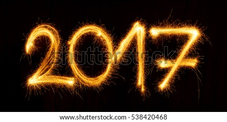 Happy New Year - 2017 with sparklers on black background