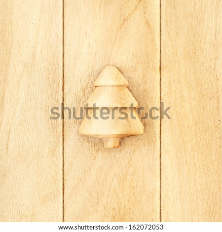 Happy New Year. Wooden vintage background with fir-tree