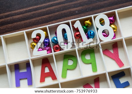 Happy new year 2018 wording and accessory decoration in wood boxes.