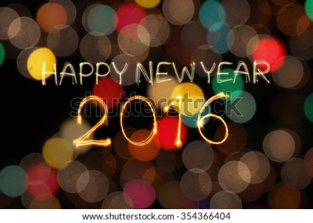 Happy New Year 2016 write sparkler firework with dirty defocused colorful light blur background - stock photo