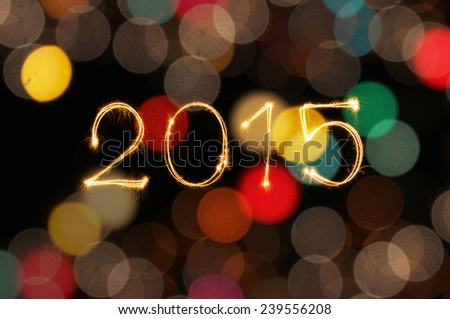 Happy New Year 2015 writing sparkle firework with dirty defocused colorful lights blur bokeh background  - stock photo