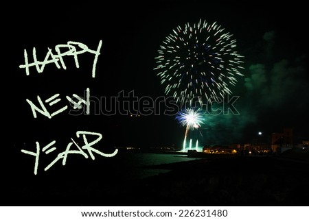 happy new year written in the night with fireworks - stock photo