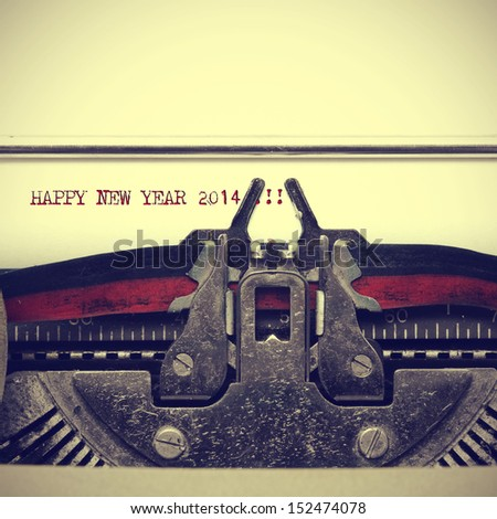 happy new year 2014 written with an old typewriter - stock photo