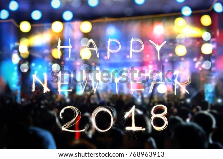 Delightful Happy New Year 2018 Written With Sparkle Firework And Abstract Blur  Celebrate Light For Background.
