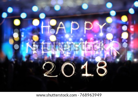 Captivating Happy New Year 2018 Written With Sparkle Firework And Abstract Blur  Celebrate Light For Background.