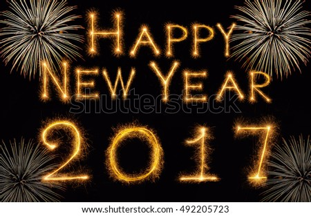 Happy new year 2017 written with Sparkle firework on black background, celebration and greeting cards concept