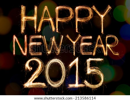 Happy new year 2015 written with Sparkle firework on bokeh background - stock photo