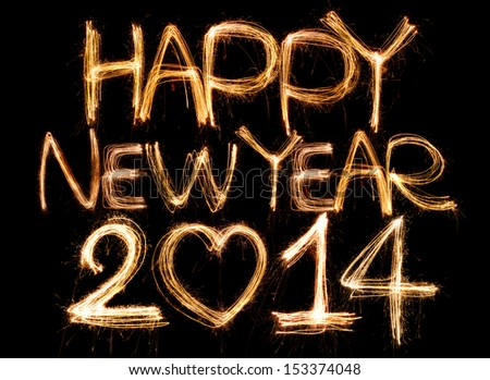 Happy new year 2014 written with Sparkling figures. on bokeh background - stock photo