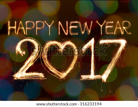 Happy new year 2017 written with Sparkling  light on bokeh background - stock photo