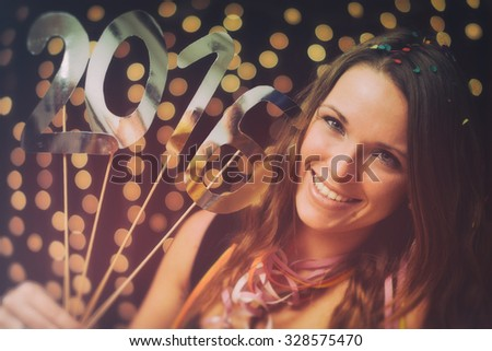 Happy new year / Young woman in a new year party - stock photo