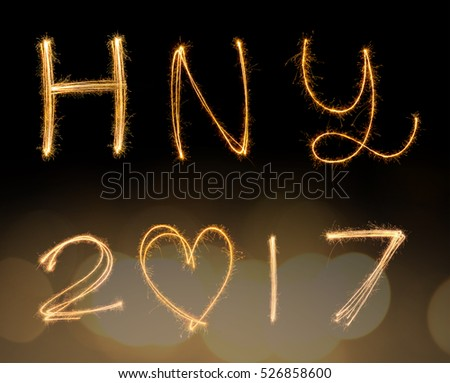 happy new years 2017 fireworks Sparkle alphabet on gold bokeh background. HAPPY NEW YEAR concept.