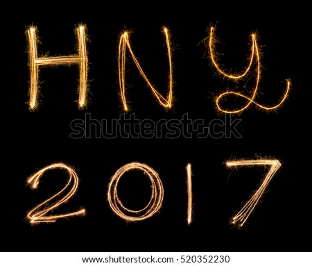 happy new years 2017 fireworks Sparkle alphabet on on black background. HAPPY NEW YEAR concept.