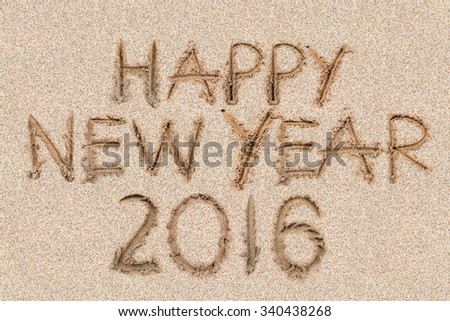 Happy New Years 2016 on the sand backgroung Texture - stock photo