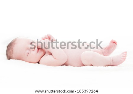 happy newborn baby girl just a week old photographed in the studio