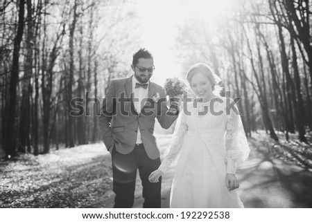 Happy newlywed couple together. Groom and bride on wedding day. - stock photo