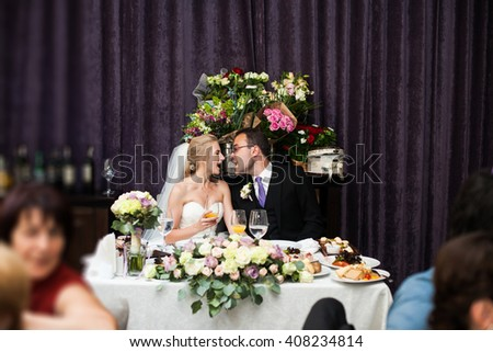 Happy newlywed man and wife having fun alone at wedding reception - stock photo