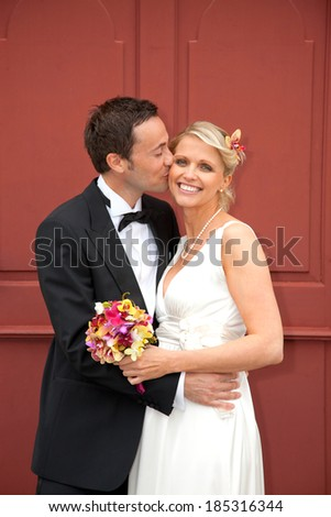 Happy newlyweds posing before wedding ceremony - stock photo