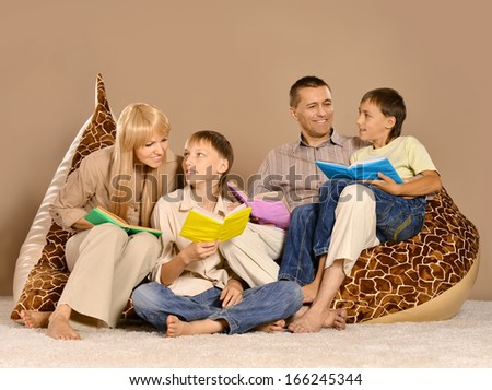 happy nice family reading books together - stock photo