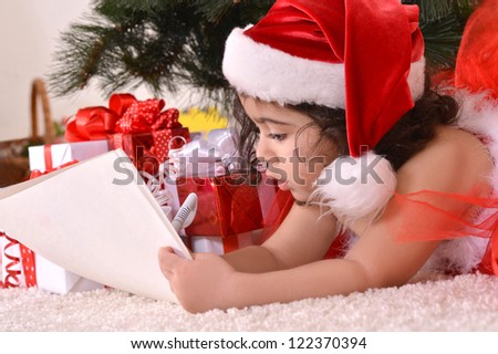 happy nice girl celebrating New Year at home - stock photo