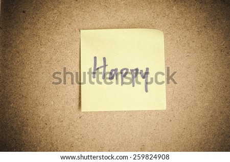 Happy note message on sticky paper by corkboard. - stock photo