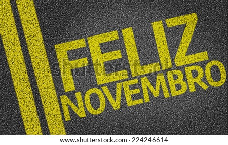 Happy November (In Portuguese) written on the road - stock photo