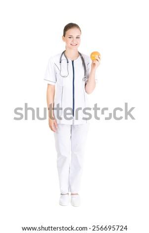 Happy nutritionist holding an orange - stock photo