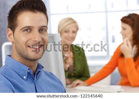 Happy office portrait, smiling businessman and female coworkers. - stock photo