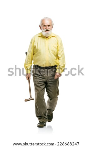 Happy old active bearded man walking without using his cane isolated on white background