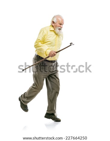Happy old active bearded man walking without using his cane isolated on white background - stock photo