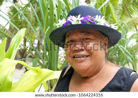 Happy old aged Polynesian Cook Islander woman smile in Rarotonga, Cook Islands. Real people.  Copy space