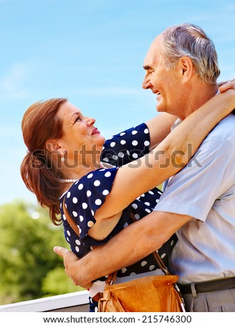 Happy old couple at summer outdoor. - stock photo