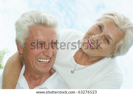 happy old couple in a summer park