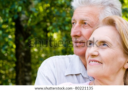 happy old couple posing at the nature