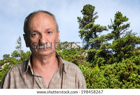 Happy old man in mountains - closeup shot. Shot in High Tatra Mountains. Slovakia. Europe.