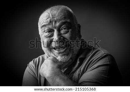happy old man looking strange - stock photo