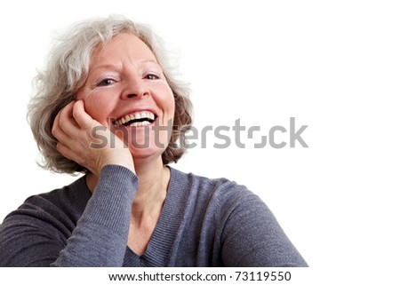 Happy old senior woman with grey hair laughing - stock photo