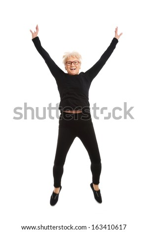Happy old woman jumping. Isolated on white.