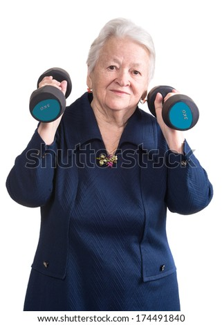 Happy old woman making fitness training with dumbbells on a white background - stock photo