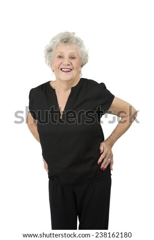 Happy old woman smiling against a white background - stock photo