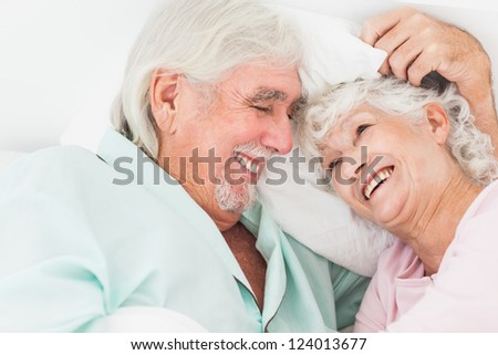 Happy older couple in bed